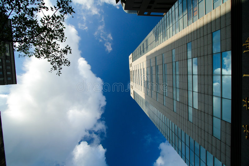 Cloud and building royalty free stock photography
