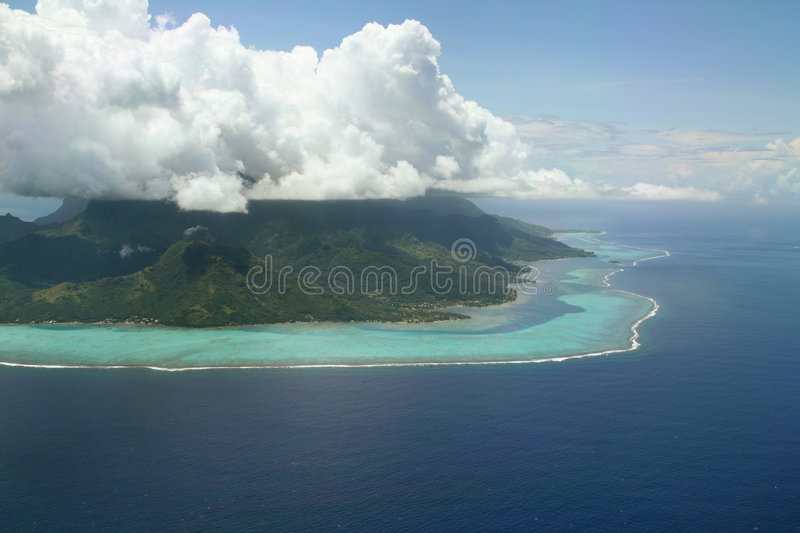 Cloud cap on volcanic island royalty free stock images