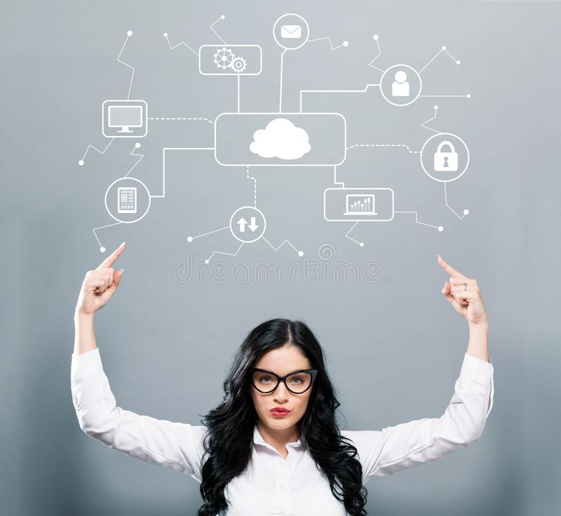Cloud computing with business woman pointing upwards stock photo