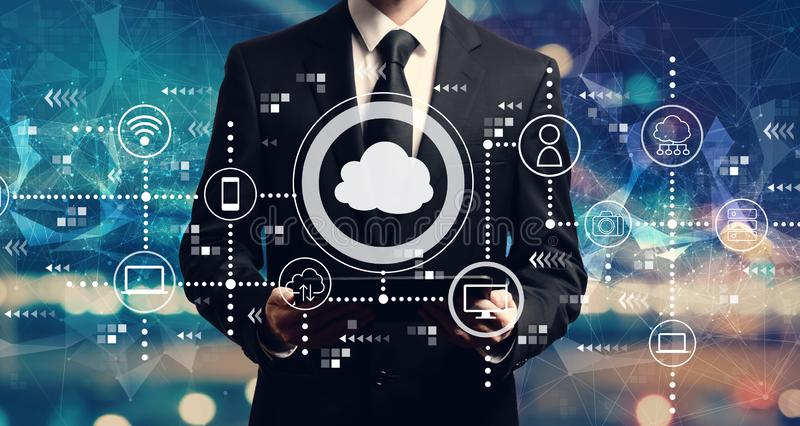 Cloud computing with businessman holding a tablet royalty free stock images