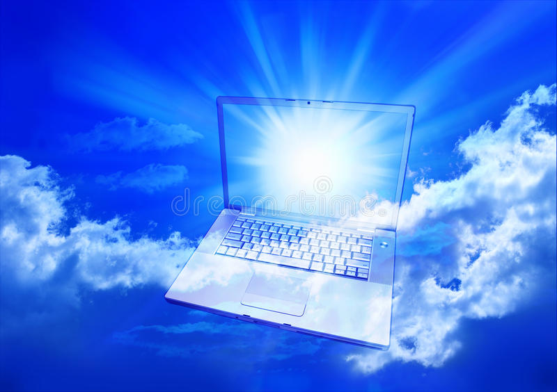 Cloud Computing Computer. A laptop computer in a blue cloudy sky