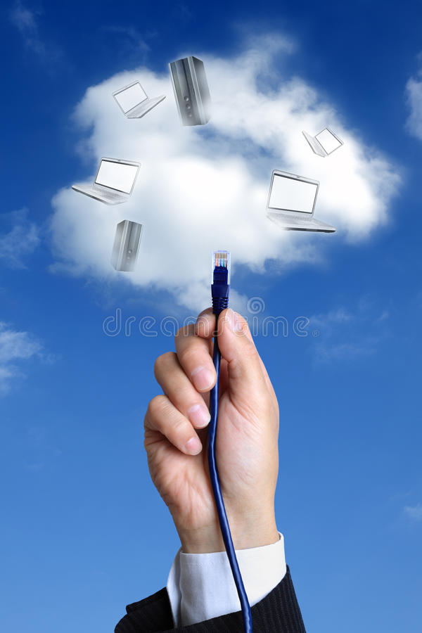 Cloud computing concept. Concept for cloud computing - busnessman hand connecting to the cloud with ethernet cable