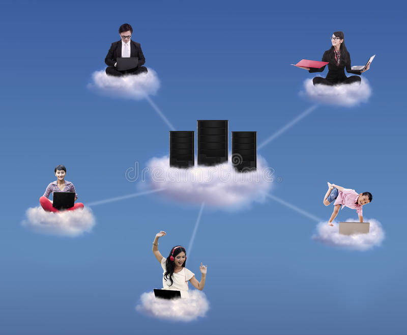 Cloud computing concept. With people working and playing on cloud and around computer servers stock photography