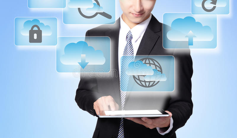 Cloud computing concept. Business man touch tablet pc with cloud computing icon in the air royalty free stock images