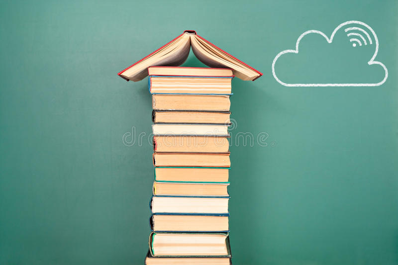 Cloud computing concept. With books as a database royalty free stock photos