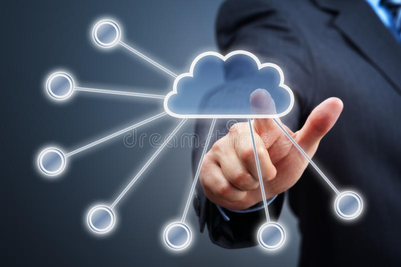 Cloud computing concept. Businessmans hand pressing cloud icon on visual touch screen concept for cloud computing