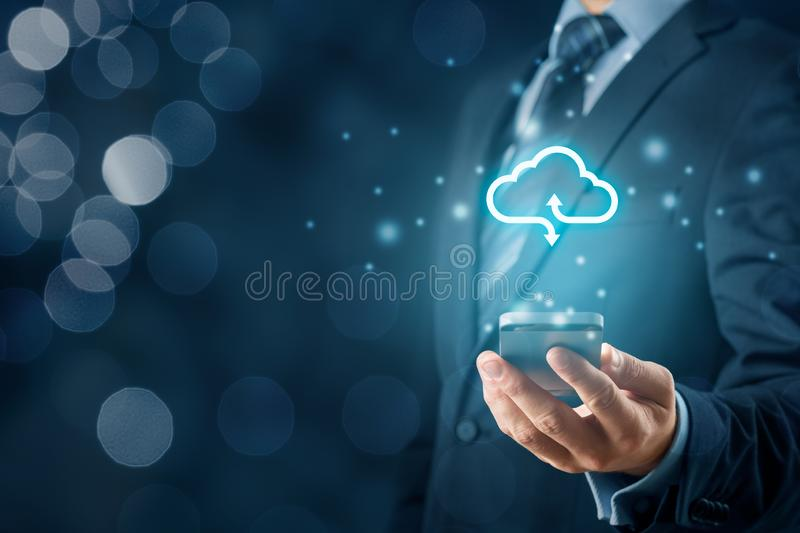 Cloud computing concept. Connect smart phone to cloud. Businessman or information technologist with cloud computing icon and smart phone royalty free stock photos