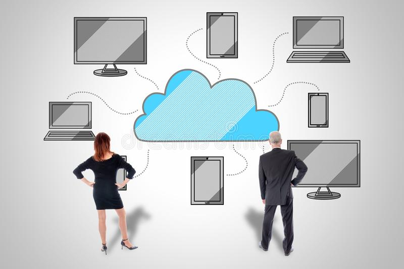 Cloud computing concept watched by business people stock photos