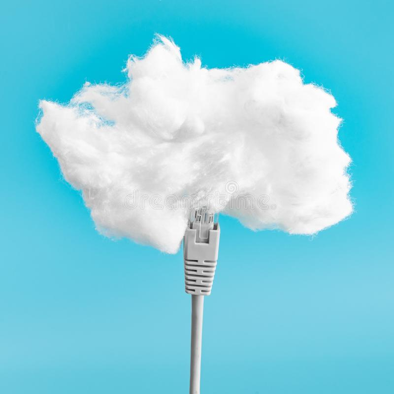 Cloud computing concept. Ethernet cable connecting into cloud. Digital data storage. Cloud uploading stock photo
