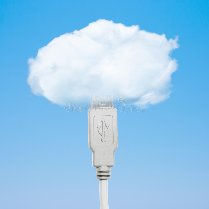 Cloud computing concept. Usb cable connected with cloud stock image