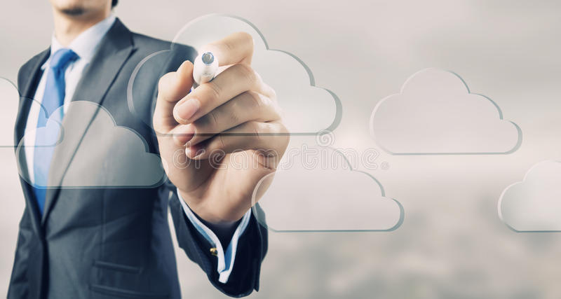 Cloud computing connectivity. Close up of businessman touching cloud icon on screen royalty free stock photo