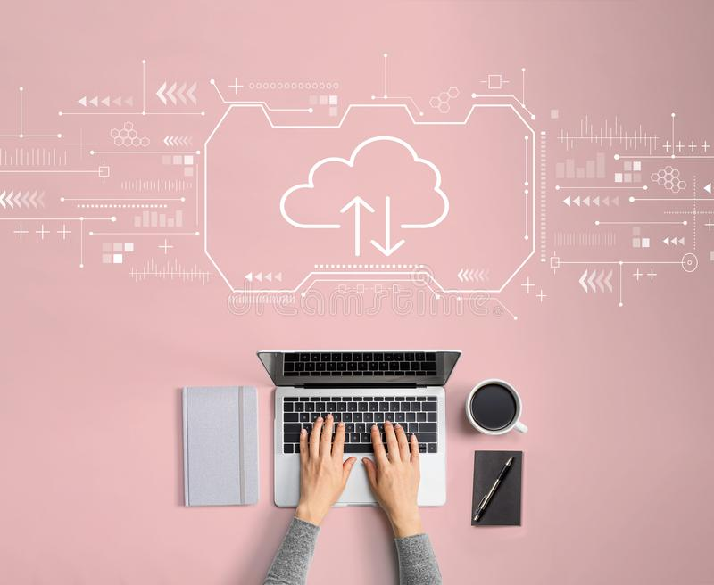 Cloud computing with person using laptop royalty free stock image