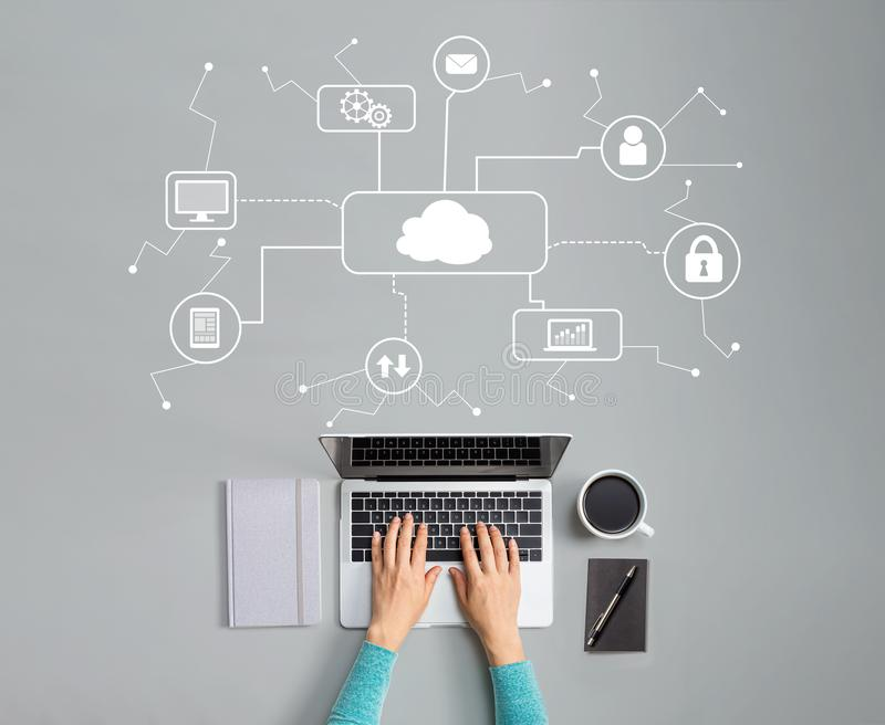 Cloud computing with person using laptop stock photo