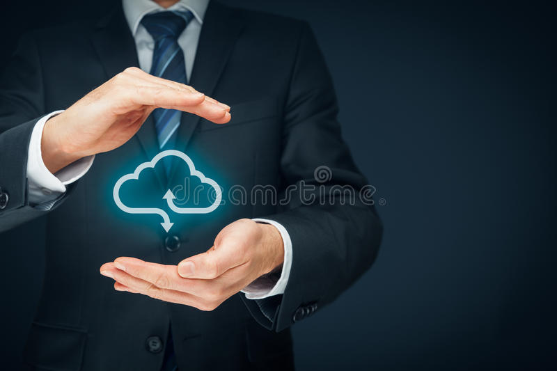 Cloud computing security concept. Connect devices to cloud. Businessman or information technologist with cloud computing icon and protective gesture royalty free stock photo
