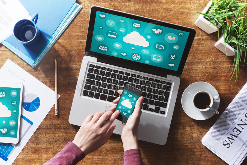 Cloud computing. And social network interface on a laptop, tablet and smartphone screen stock photos