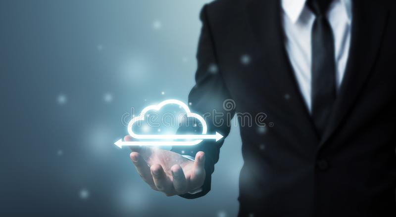 Cloud computing and technology network connection concept, Businessman hand holding icon cloud server stock images