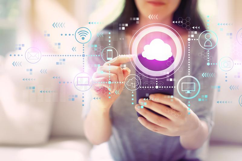 Cloud computing with woman using a smartphone stock photos