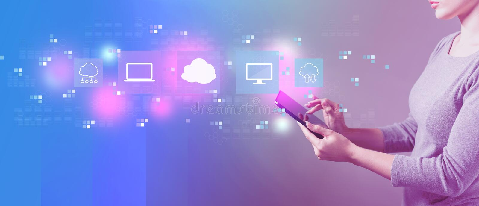 Cloud computing with woman using a tablet. Cloud computing with business woman using a tablet computer royalty free stock photo