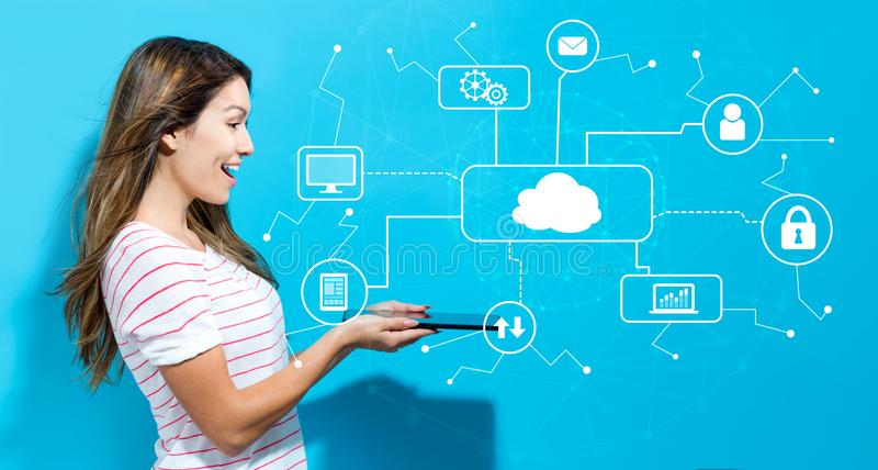 Cloud computing with young woman using tablet. Cloud computing with young woman using her tablet royalty free stock photography