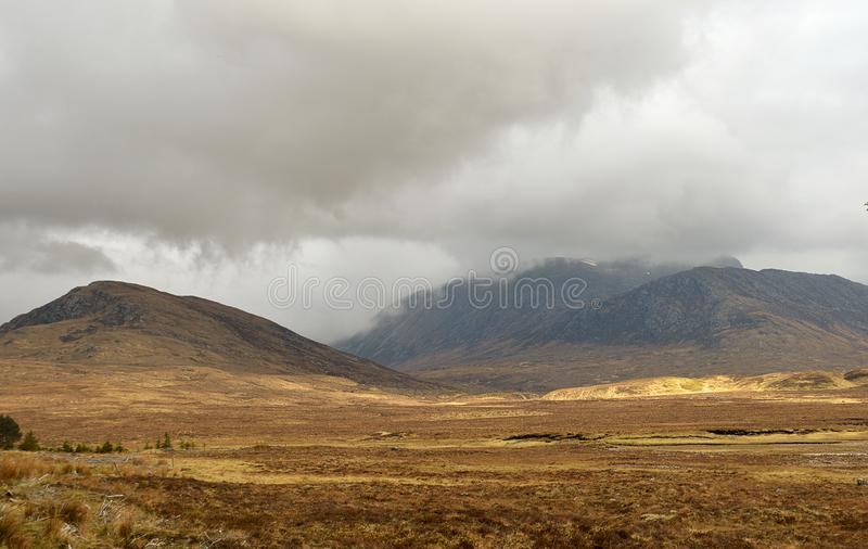 Cloud covered mountain in Scottish Highlands royalty free stock photo
