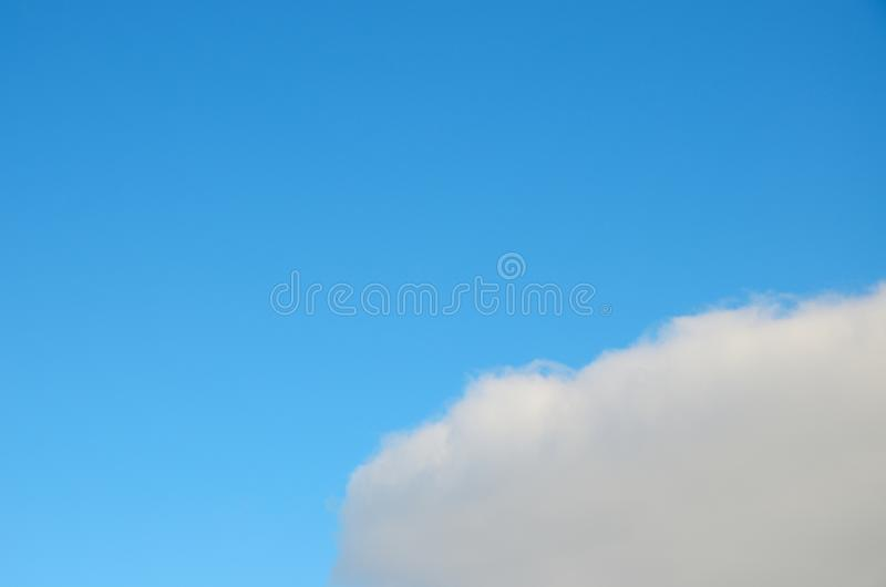 Cloud with curved growing edge in blue sky royalty free stock images