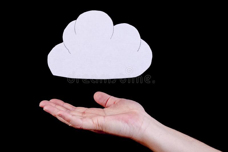 Cloud data computing concept. Cloud computing, identity theft and data protection concept. Cloud cutout with a human open hand underneath the cloud stock photos