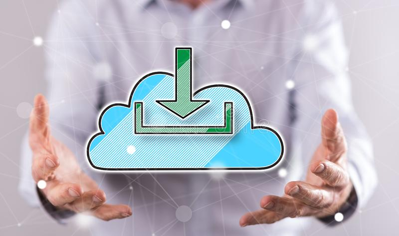 Concept of cloud download. Cloud download concept above the hands of a man in background stock photography