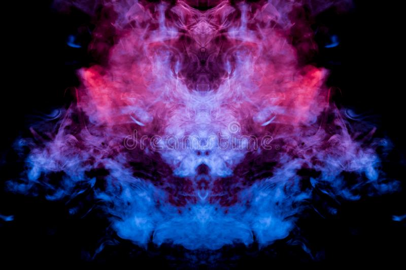 The cloud of dynamic smoke exhaled from the vape is highlighted with pink blue and violet light and rising to take the mystical stock photography