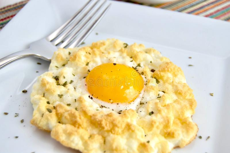 Cloud egg on a white plate stock images