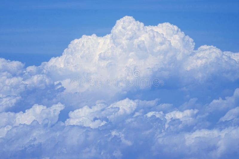 Flying above the clouds at 30,000 ft royalty free stock photo