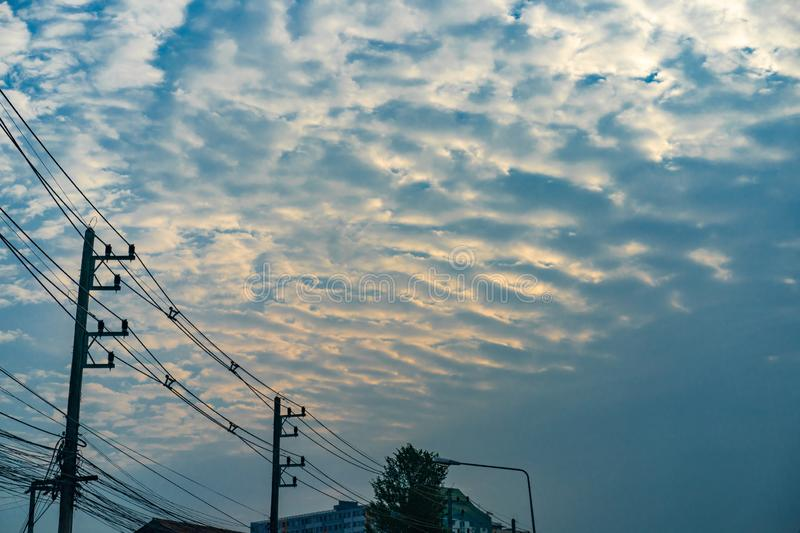 Cloud and gold light with electricity cable in the twilight time royalty free stock photo