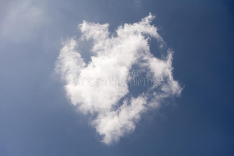 Cloud heart in blue sky stock images