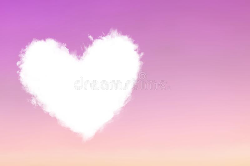 Cloud heart fly in violet pink sky royalty free stock photography