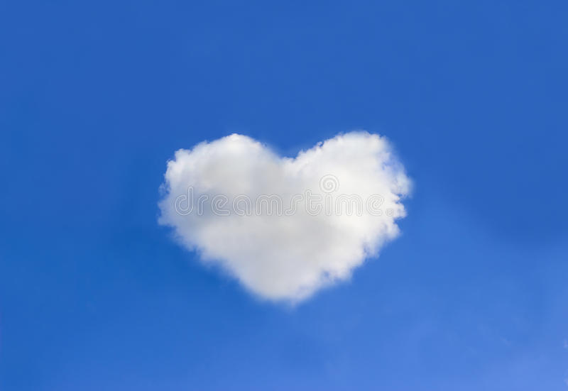 Cloud with heart shapes on blue sky background royalty free stock photos
