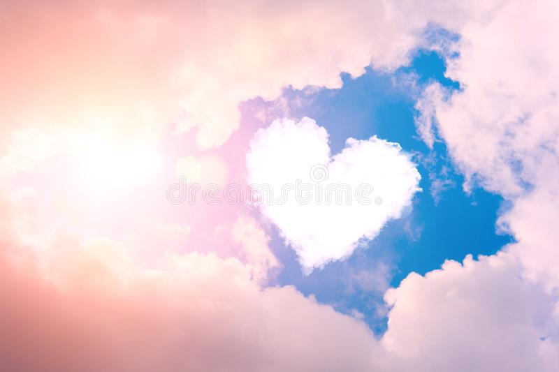 Cloud heart in the sky in the clouds and sunshine.  royalty free stock photos