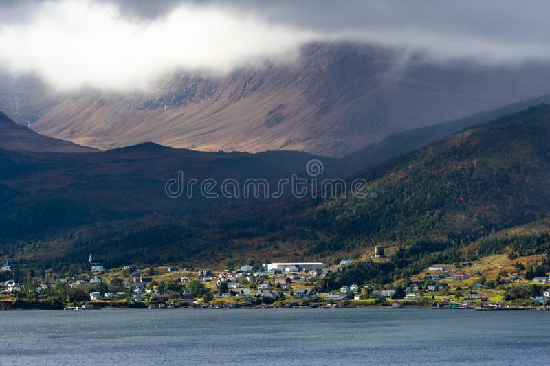 Cloud lifting from the famous Tableland Mountains at Bonne Bay. Cloud is lifting from the Tableland Mountains over Bonne Bay seen from the Norris Point Lookout royalty free stock photos