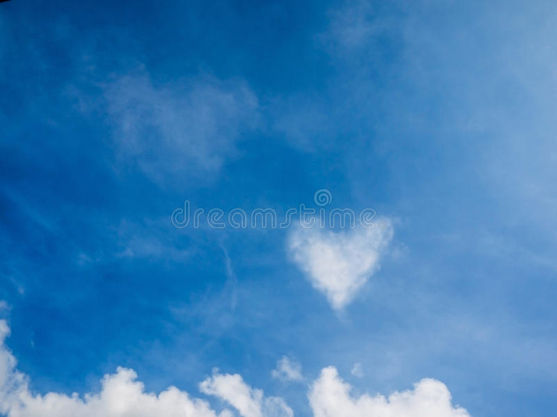 Cloud look like heart on the blue sky on sunshine day royalty free stock images