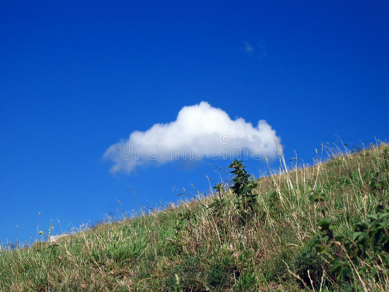 Cloud and meadow royalty free stock photos