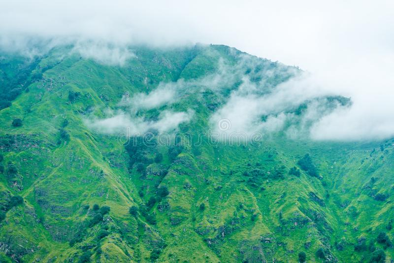 Cloud moving over mountain in himalayas, sainj valley, himachal pradesh, india stock photos