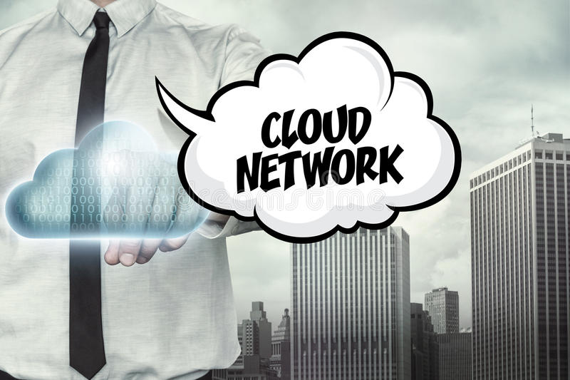 Cloud network text on cloud computing theme with. Businessman on cityscape background royalty free stock photo
