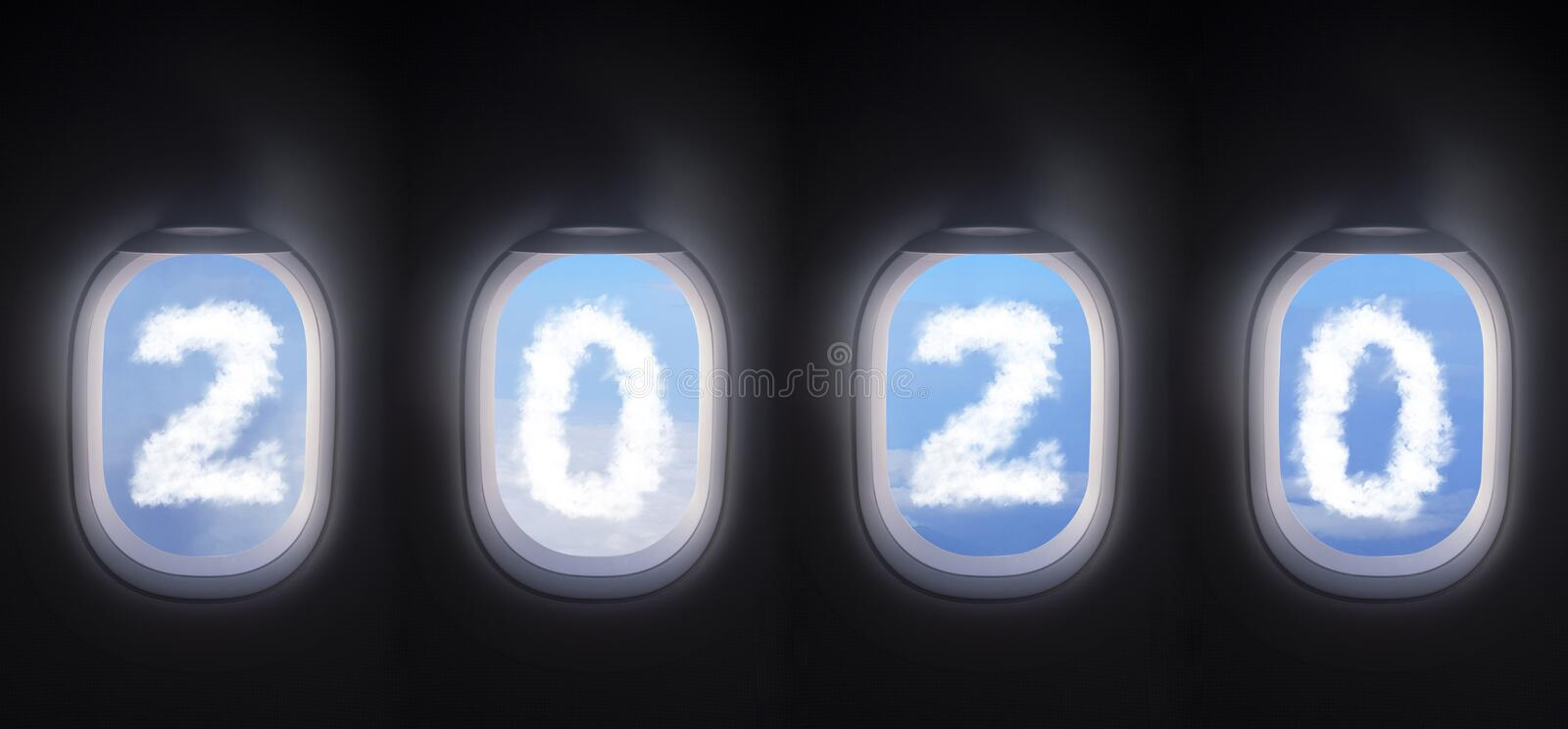 Cloud 2020 outside the plane window, four airplane windows open white window shutter wide with blue sky view and white cloud royalty free stock image