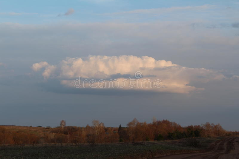 Cloud over the field royalty free stock photos