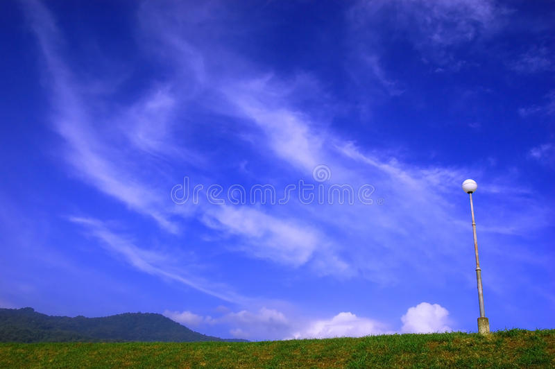 Cloud over hill. A cloud float over the hill stock photography