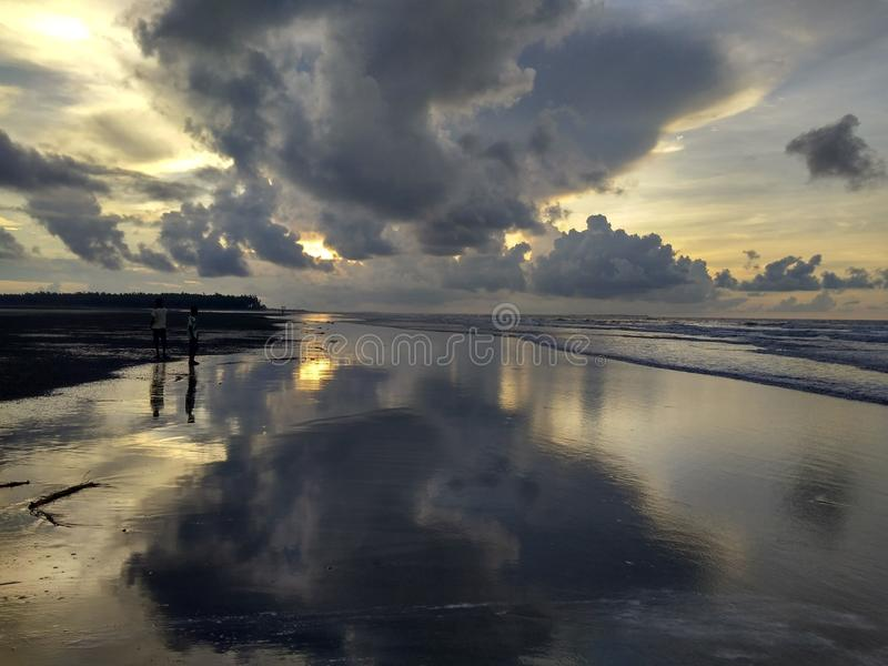 Cloudy beach royalty free stock photography