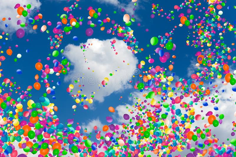 Cloud in the sky with many color air balloons. Cloud in the sky with many colorful air balloons flying around, festive celebration concept royalty free stock images
