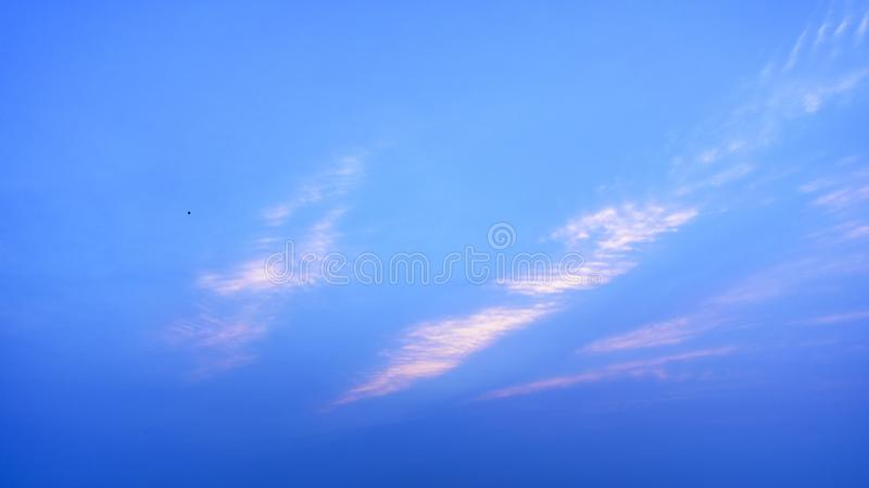Cloud and Sky play with sunlight. Various types of cloud formations in the sky and coloring in different ways during sunset and sunrise stock photo