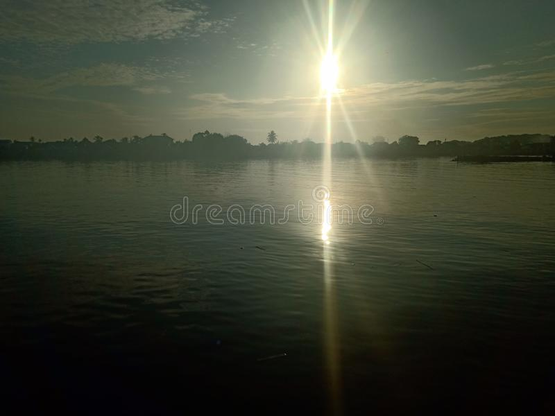 Cloud in the sky and the sun in the river. Beautiful royalty free stock image