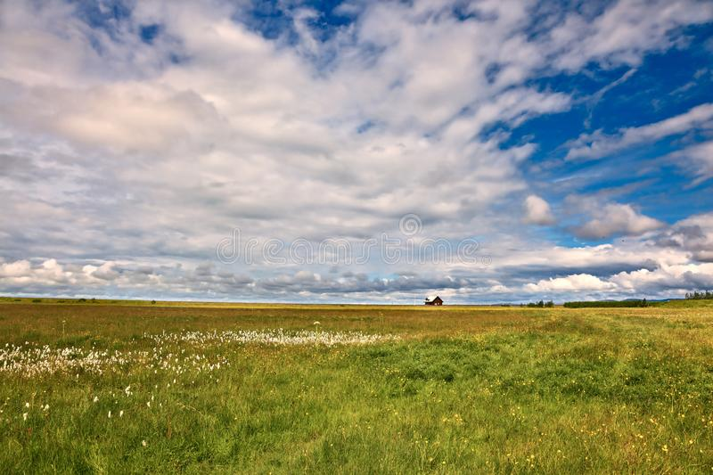 The  cloud sky. Warm summer days in Iceland. Green meadows and cloud sky stock photo