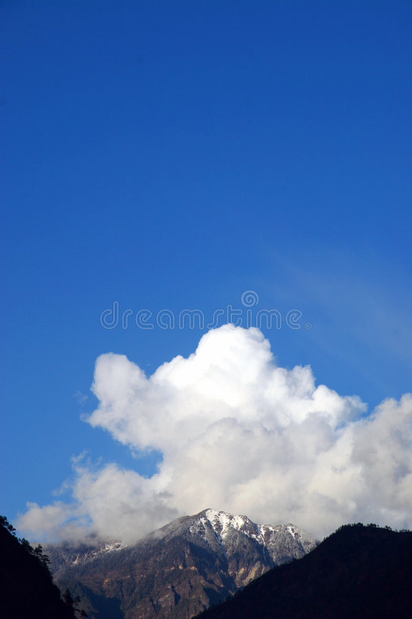 Download Cloud And Snow Mountains Stock Images - Image: 1403444