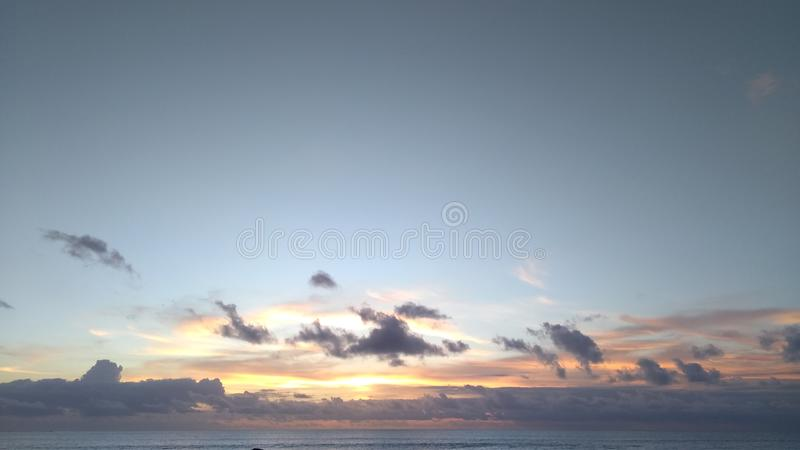 CLOUD THE SUNSET. IN KUTA BEACH BALI INDONESIA royalty free stock images